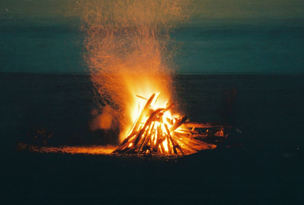 A fire burning in the darkness of night