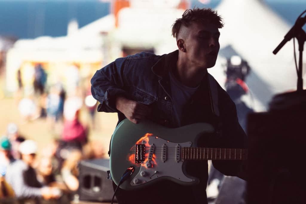 Sam Fender performing