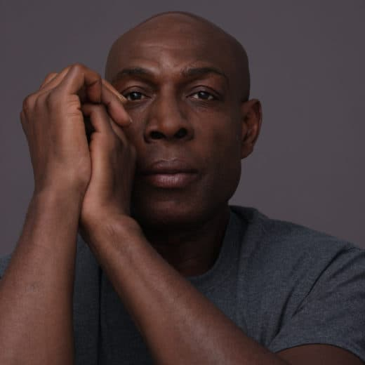 Frank Bruno staring at the camera hands clasped