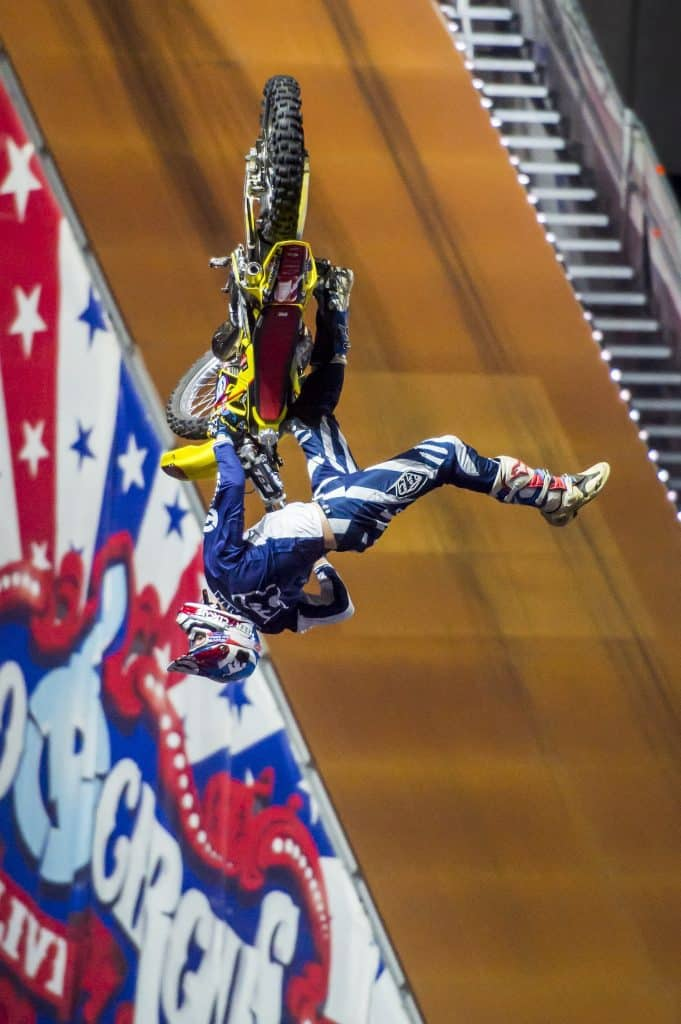 travis pastrana doing a dangerous trick on his motorbike