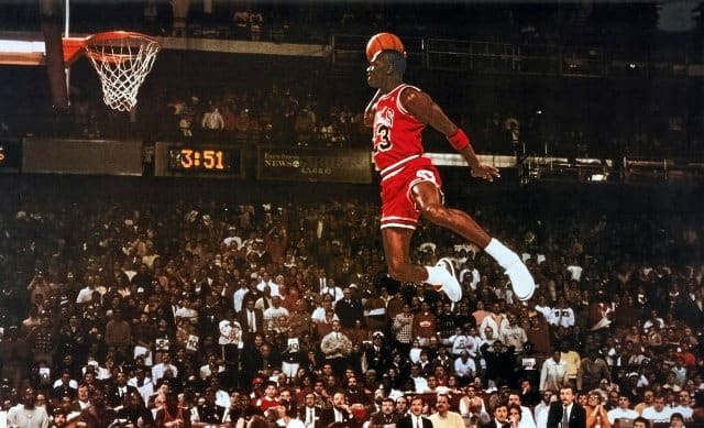 Michael Jordan dunking a ball playing for the Chicago Bulls