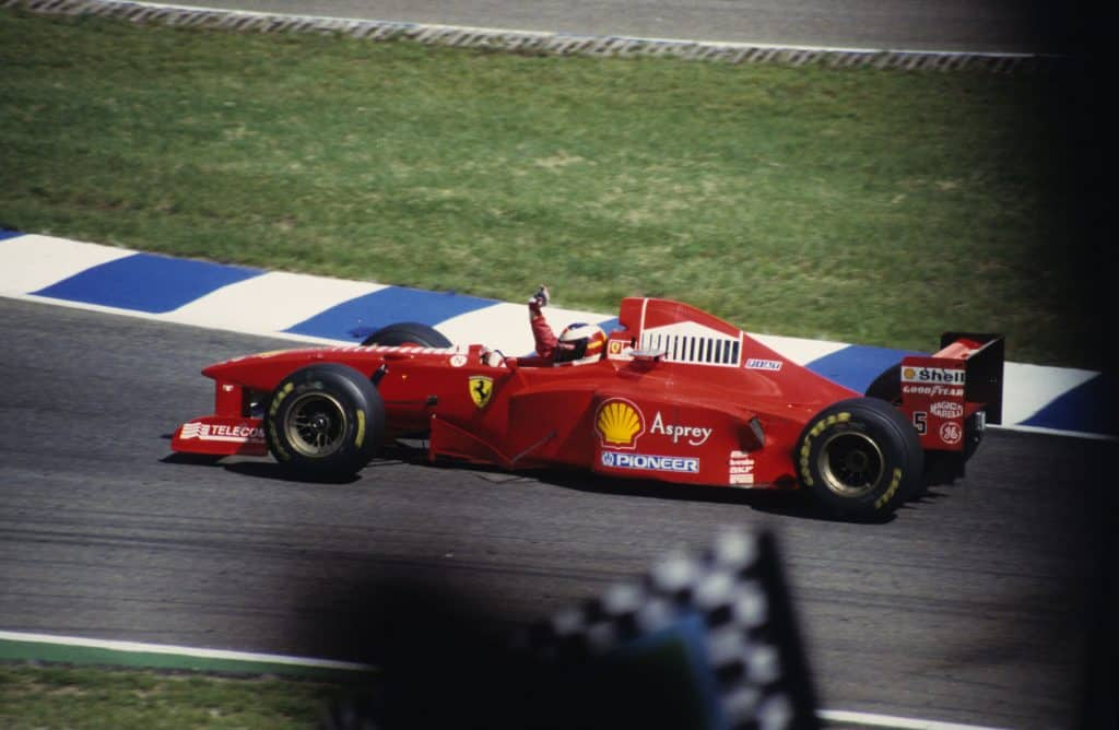 Michael Schumacher waving from his winning racing car