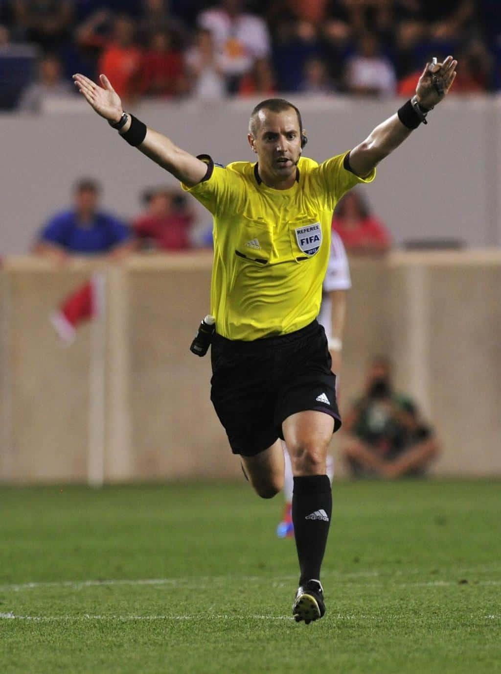 Referee Mark Geiger making a VAR decision