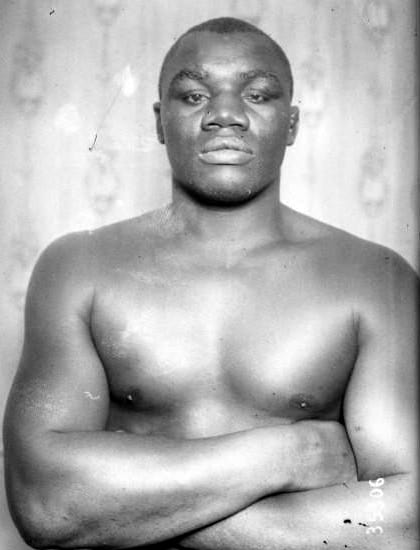Boxer sam Langford with arms crossed