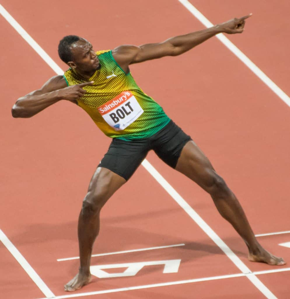 Usain Bolt posing on the track after a win