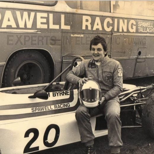 A young tommy poses for a photo in his racing attire
