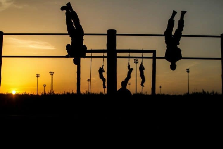 Soldiers negotiate an obstacle course at dusk