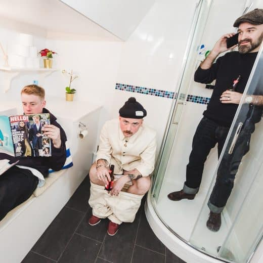 The ULLAC denim boys pictured in a bathroom