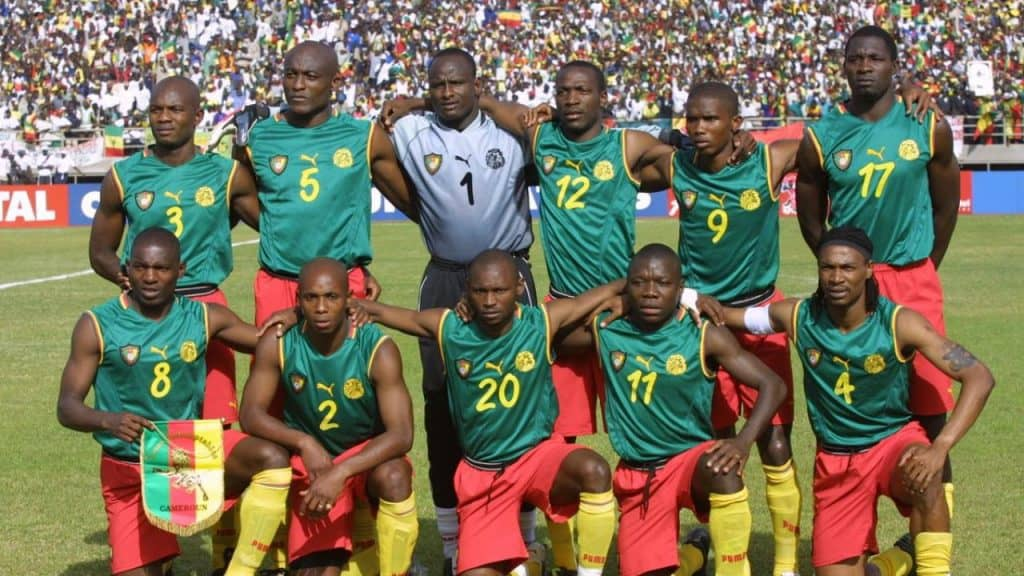 Cameroon pose for a pre match photo in their memorable 2002 sleeveless kit