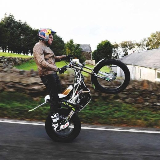 Dougie Lampkin attempting to wheelie full TT Course
