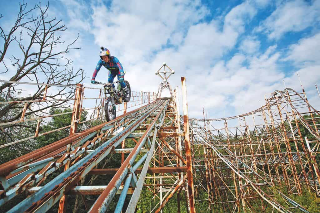 Dougie Lampkin riding down a roller coaster