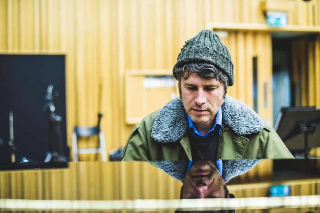 Gruff Rhys at a piano