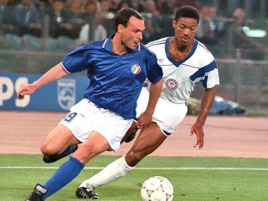 Salvatore Schillaci takes on a defender in Italy's iconic 1990 kit