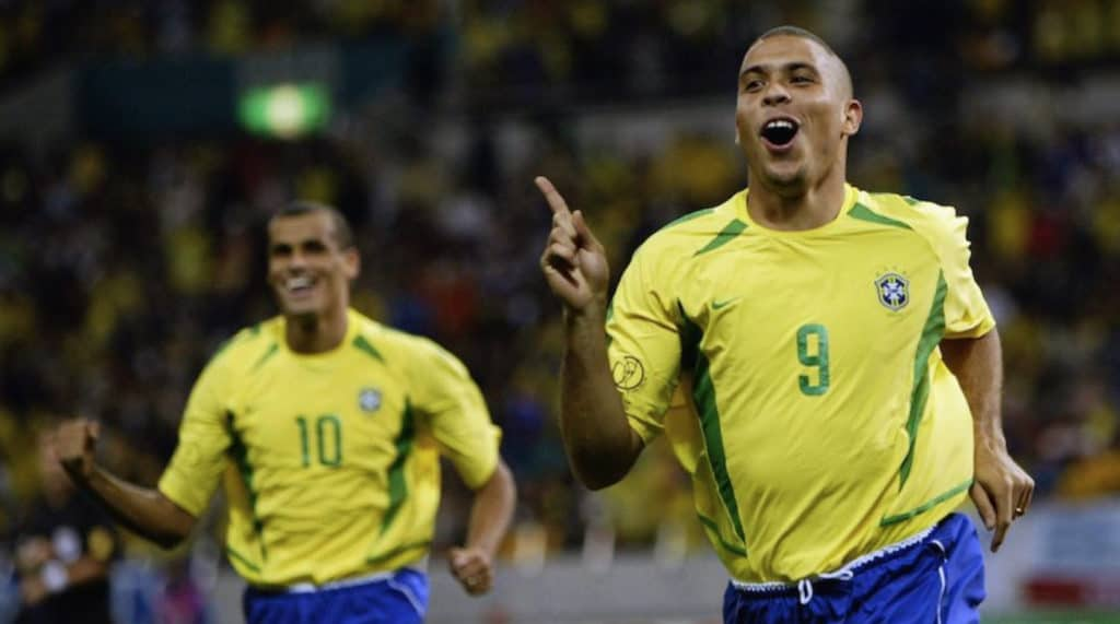 Golden Boot winner Ronaldo celebrates scoring for Brazil