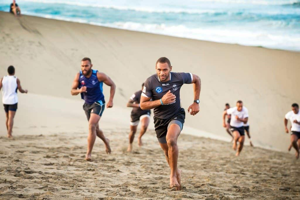 Members of the Fiji 7s squad run up a sandhill