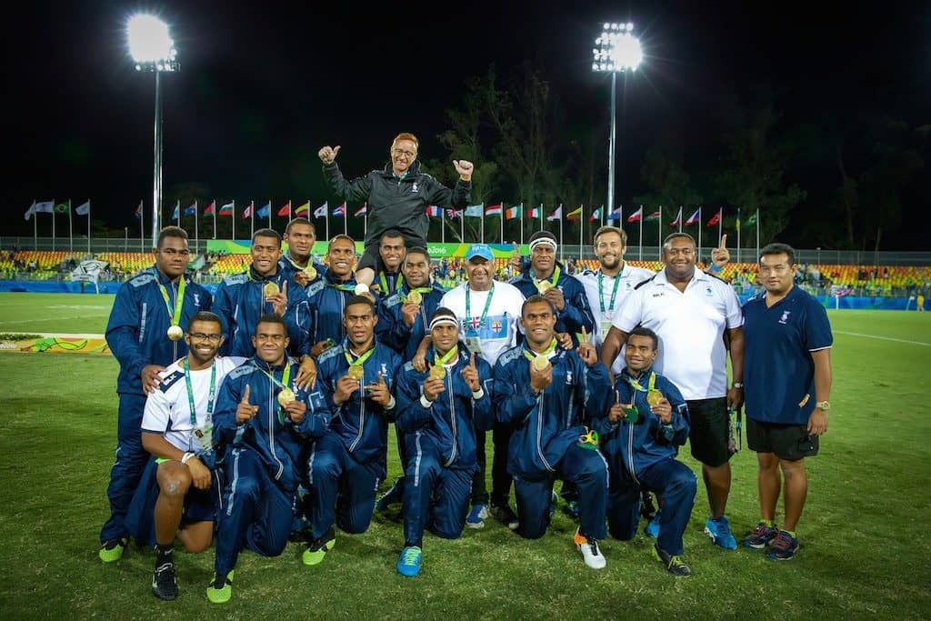 The Fijian golden boys show off their gold medals with coach Ben Ryan back centre of shot