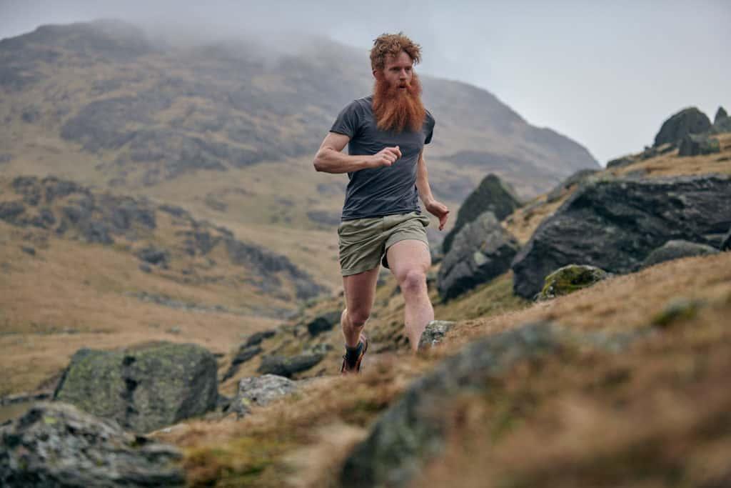 Adventurer Sean Conway running through the hills