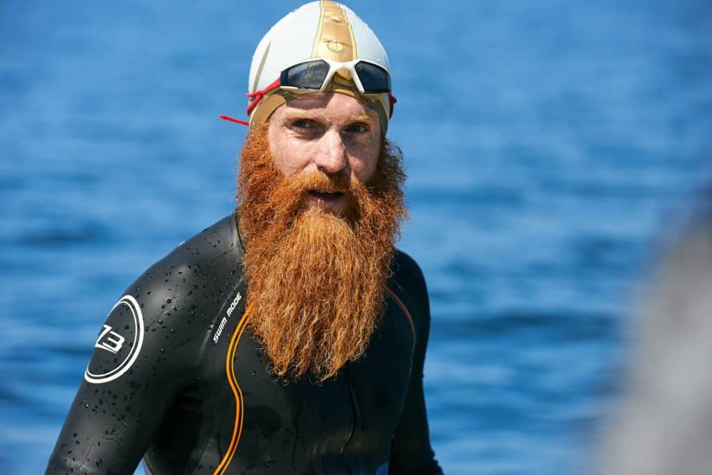Adventurer Sean Conway in a wetsuit, swim hat and goggles