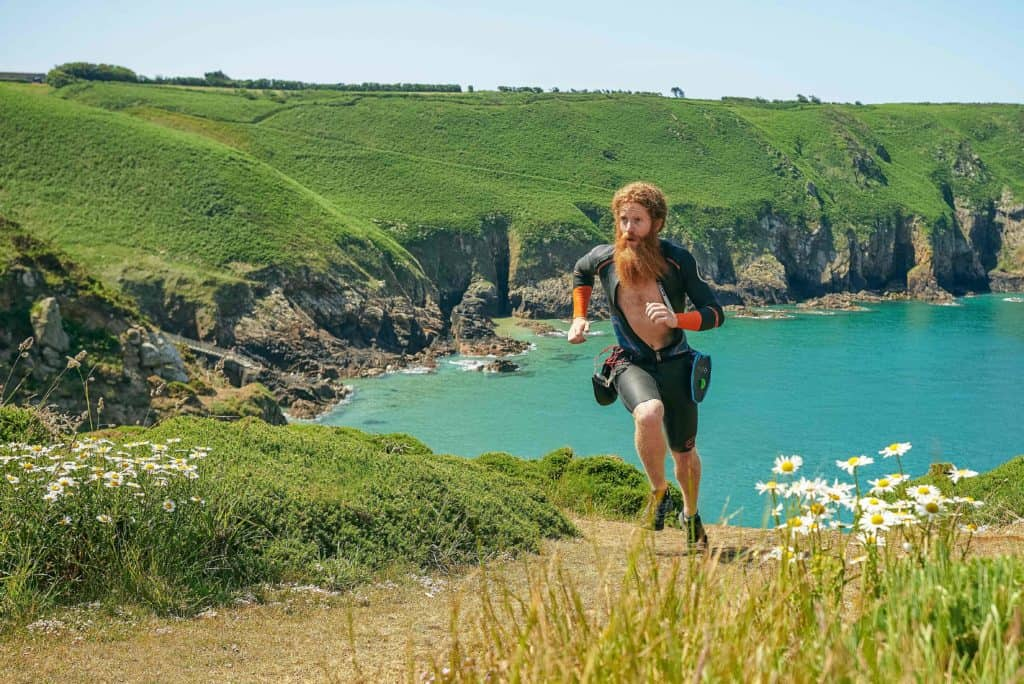 Sean Conway running in the countryside