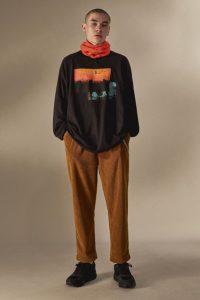 Model wearing brown corduroy trousers