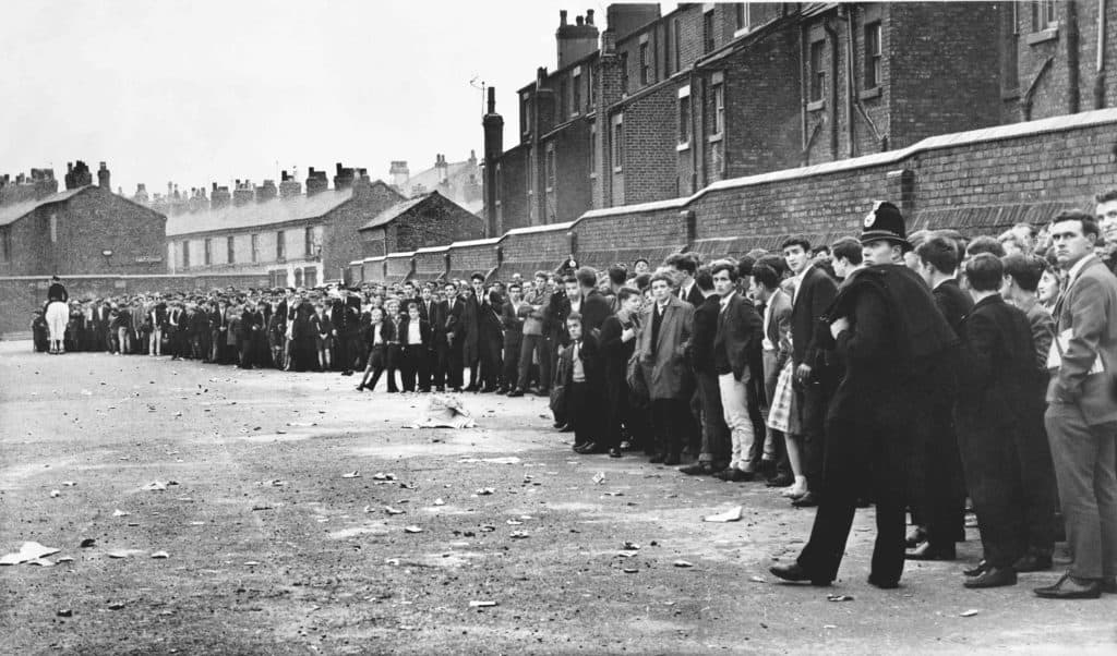A huge crowd of Liverpool fans queue for the derby with Everton