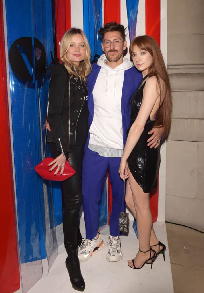 Henry Holland in blue suit and white trainers poses with Laura Whitmore and Nicola Roberts