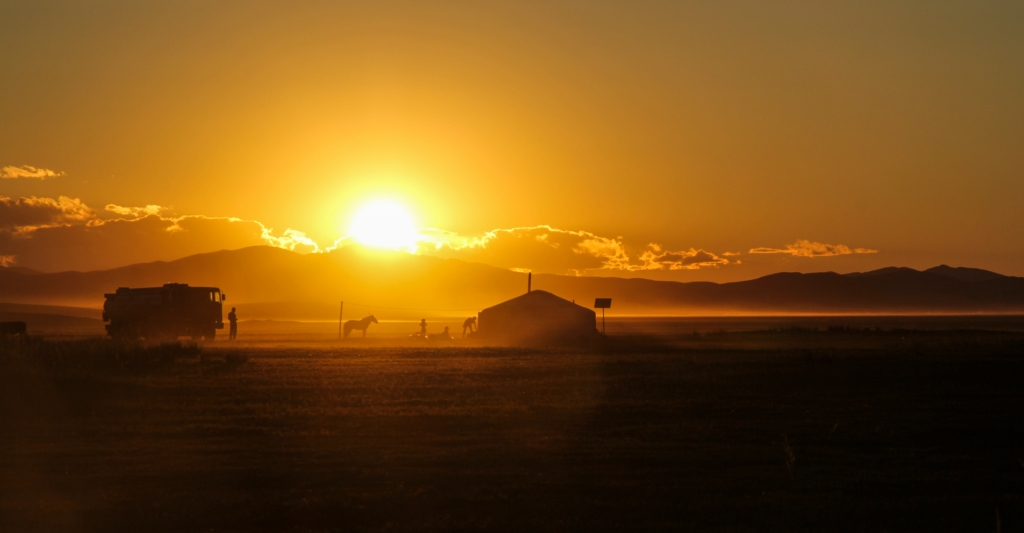The sun setting over an American ranch