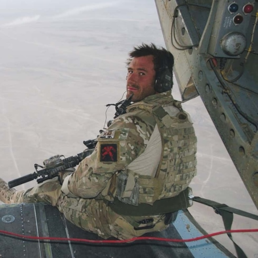 Jason Fox in back of Chinook