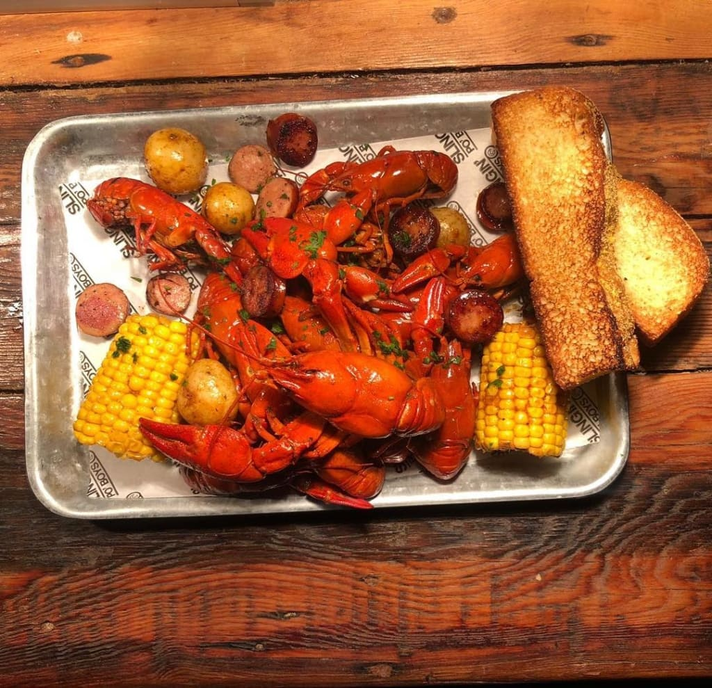 Lobster and sweetcorn on silver tray