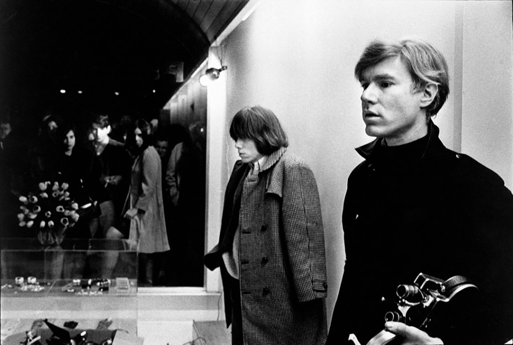 Brian Jones and Andy Warhol at Paraphernalia launch, from In and Out of Warhol's Orbit: Photographs by Nat Finkelstein
