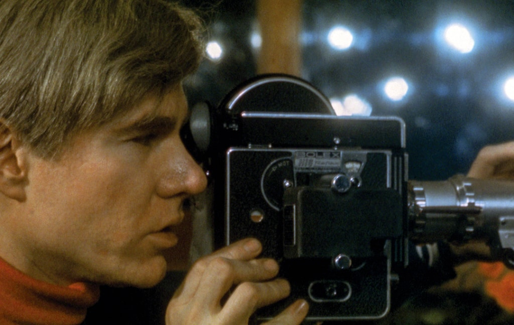 Andy Warhol with a Bolex camera, from In and Out of Warhol's Orbit: Photographs by Nat Finkelstein