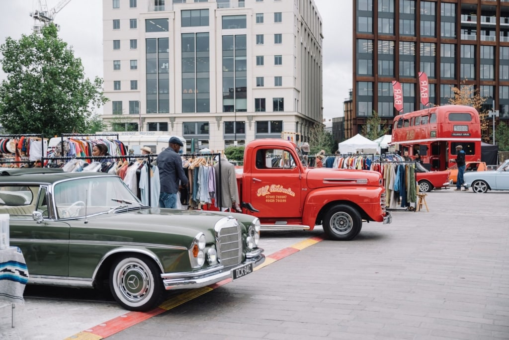 Vehicles and clothes stalls at the classic car boot in Kings Cross
