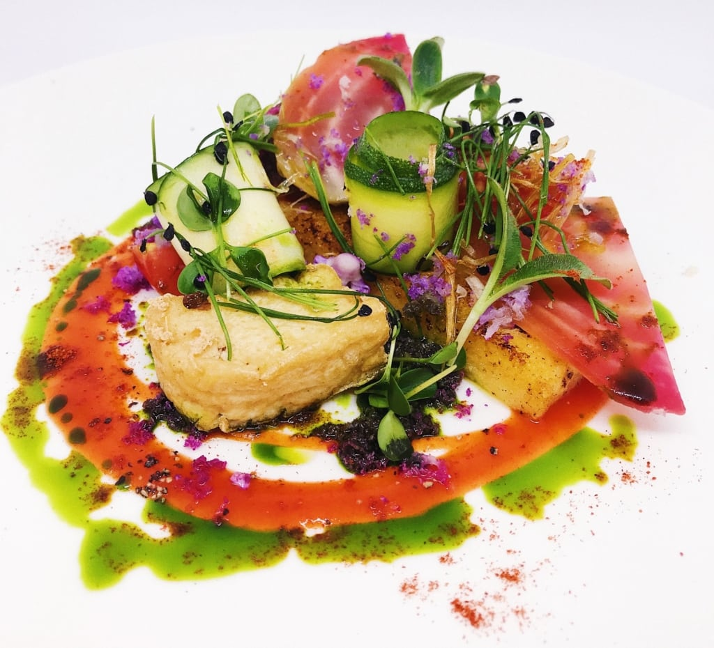 A plate full of brightly coloured vegetable creations