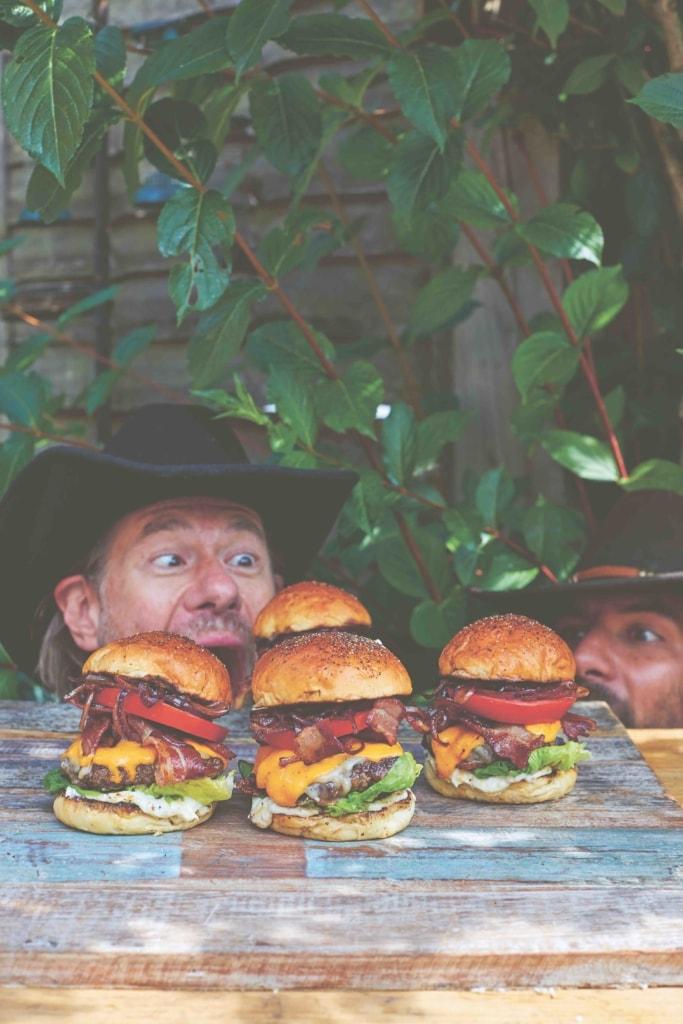DJ BBQ and his buddy T-Bone looking at the DJ BBQ burger