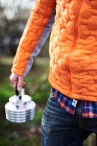 A man carrying a kettle wearing a Men's Impendor Thermoball Jacket