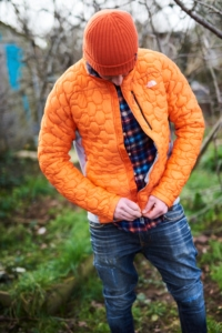 A man zips up a North Face Men's Impendor Thermoball Jacket