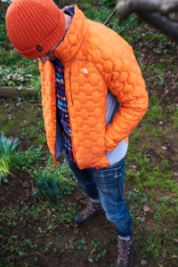 A man wearing a North FaceMen's Impendor Thermoball Jacket and Finisterre beanie