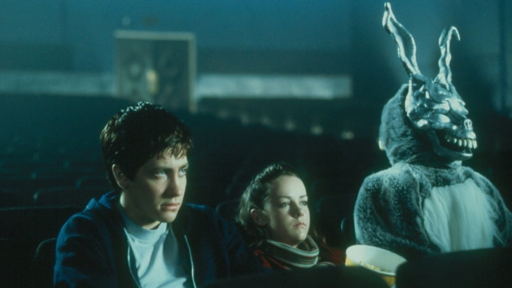 Donnie Darko and Frank the rabbit sitting in a cinema from film Donnie Darko