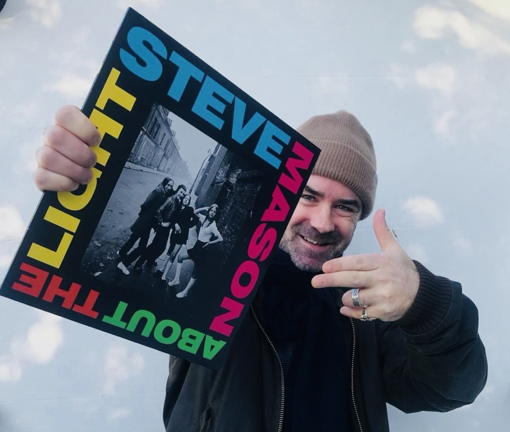 Steve Mason holding his LP