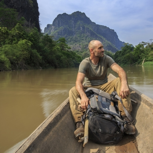 Ed Stafford on a long tail boat in southern Laos.