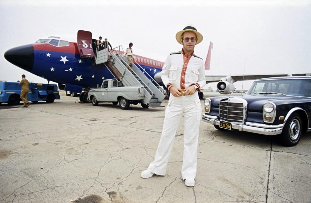 English singer Elton John on an airport runway in California during his 1974 US tour.