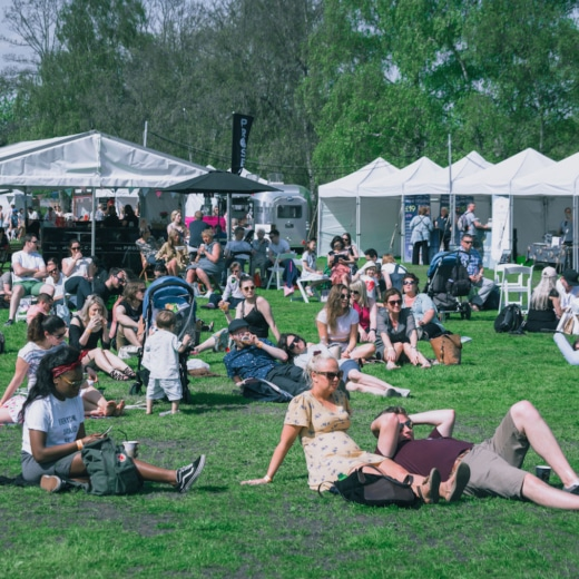 Visitors to FesTeaVal sit on the grass at one of the best of what's on in April in the UK