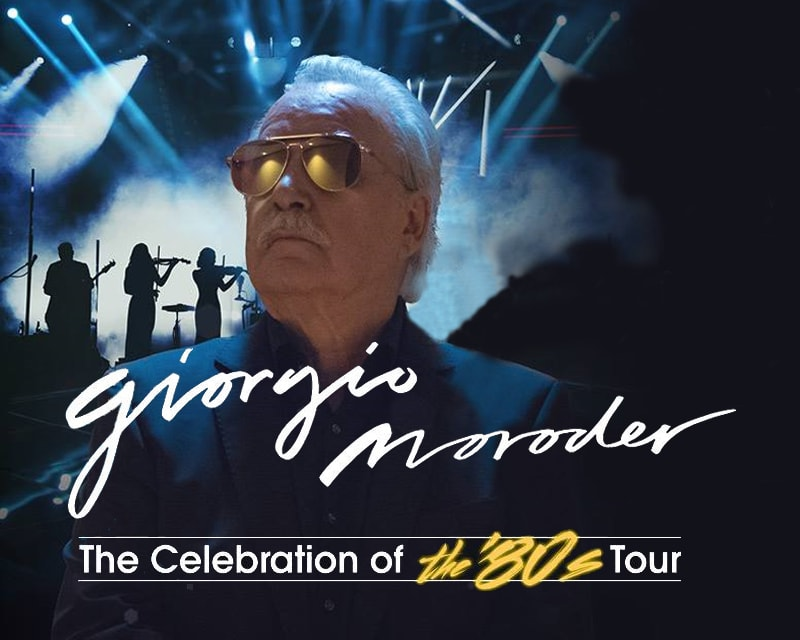 Giorgio Moroder wearing gold sunglasses