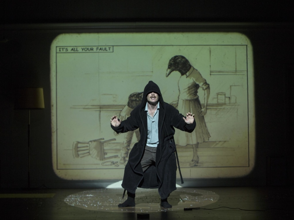 An actor performs on a theatre stage