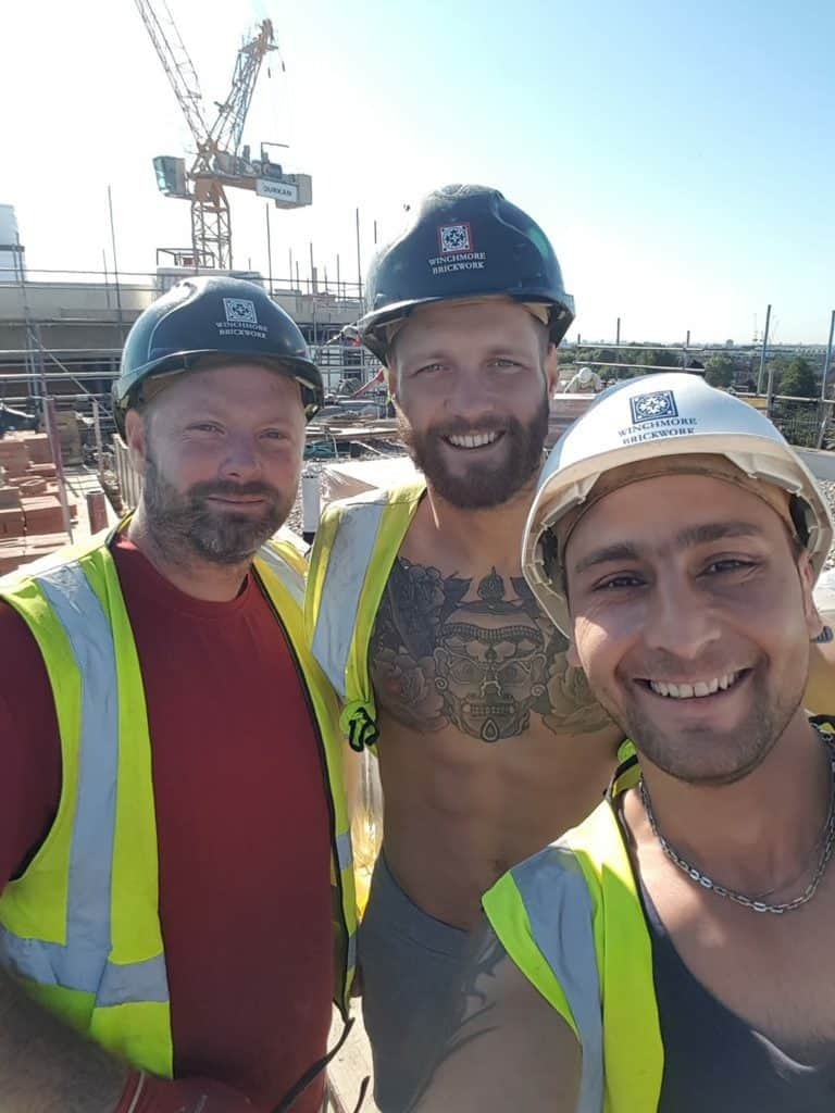 Boxer Mitchell Frearson on a building site with work mates