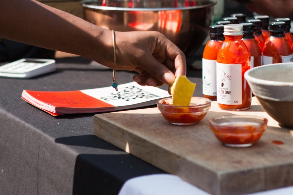 Hot sauce being dipped into