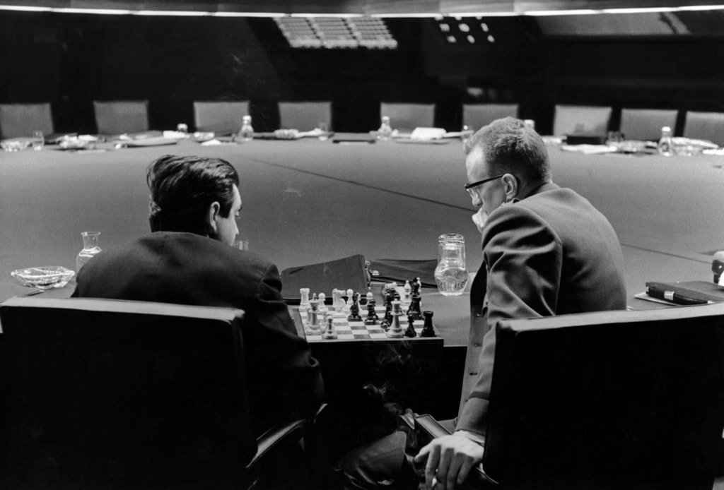 Stanley Kubrick and George C. Scott playing chess in the War Room, in a break during filming of Dr. Strangelove
