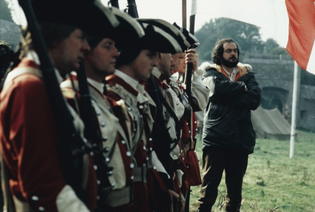 Stanley Kubrick stands near troops on the set of Barry Lyndon