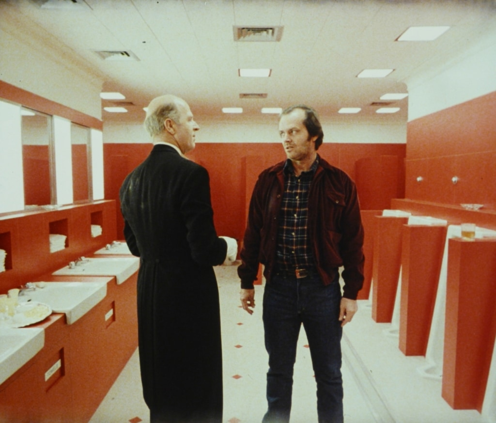 Grady (Philip Stone) and Jack Torrance (Jack Nicholson) stand in the toilet of The Overlook Hotel