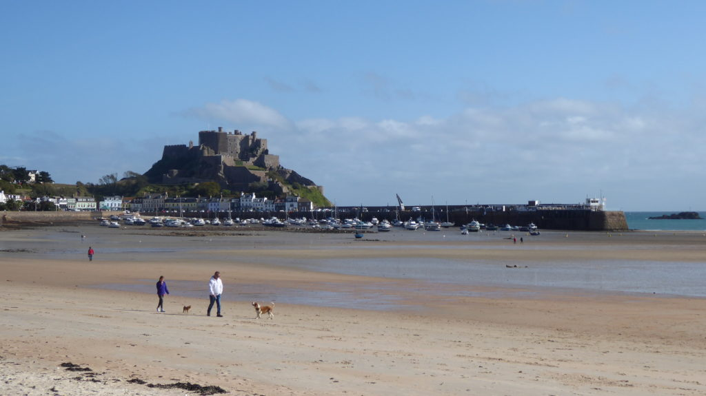 Gorey Harbour in Jersey viewed from the beach with Mont Orgueil Castle in the background